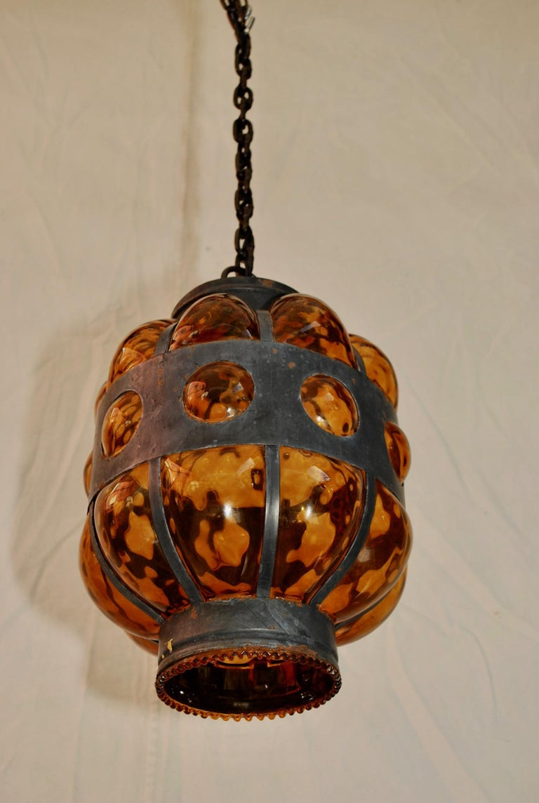 An elegant hand blown glass into the frame, could be Murano ??, the height is with out the chain.