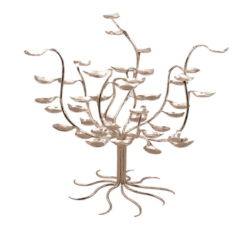 Two of the best Sensalia craftsmen made this exquisite tree by hand over a period of ten days: each of the 48 small trays shaped as leaves are hammered and folded by hand and then attached to its branch. This superb piece can be used on the dining