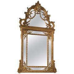 Elegant Louis XVI Style Giltwood Cushion Mirror, 19th C with Mask of Minerva