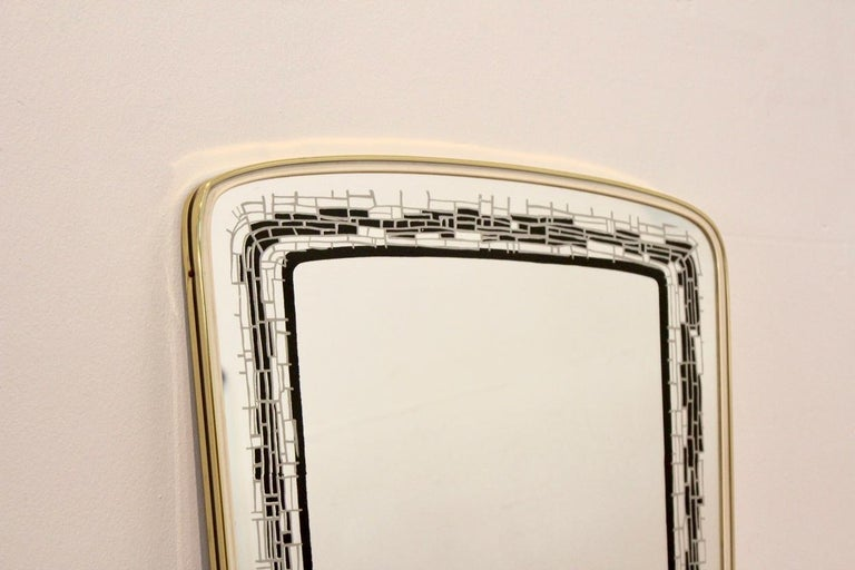 Beautiful brass framed mirror made in France. Very elegant with a beautiful and unique black mosaic lining in the glass and in very good condition.