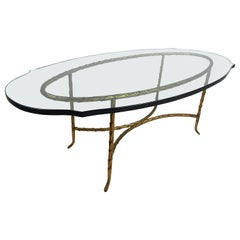 Elegant Mid-Century Modern Brass Base Coffee Table with a Sculpted Glass Top