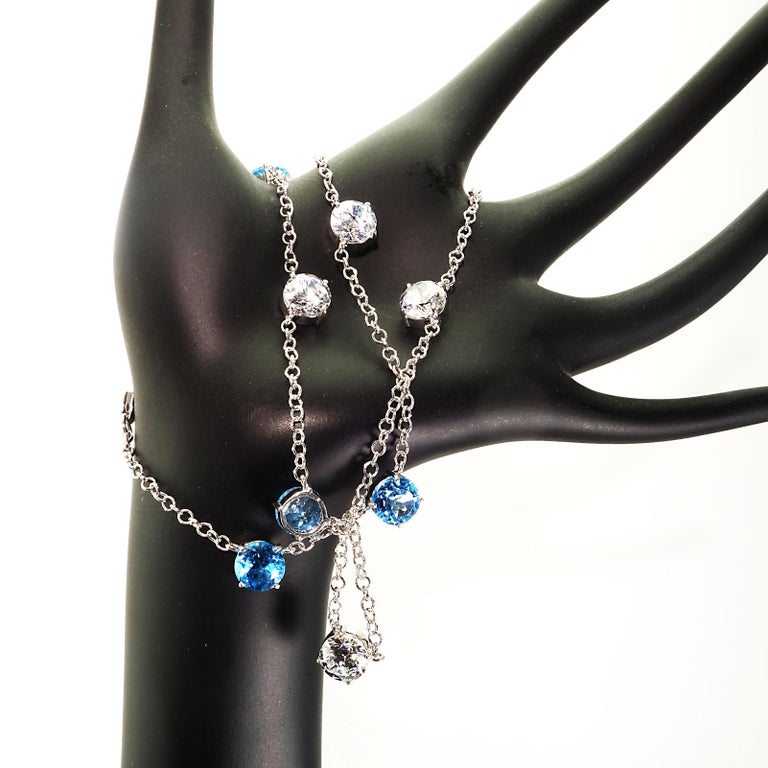 Elegant necklace of Blue Topaz and White Cambodian Zircon gemstones For Sale 1