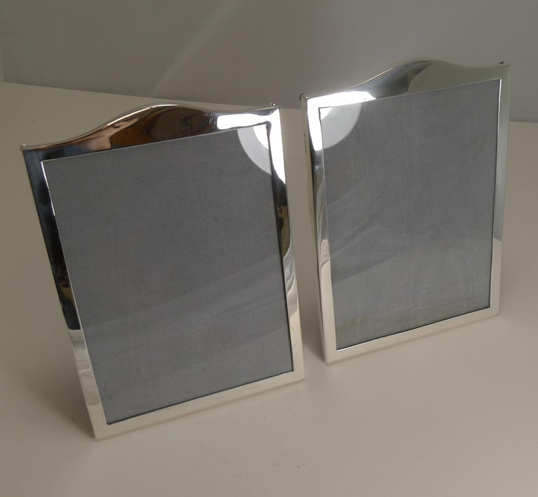 A very smart and elegant pair of photograph frames made from sterling silver fully hallmarked for Birmingham 1919, celebrating their centenary this year, therefore a true antique pair.  The backs are made from solid English Oak with folding easel