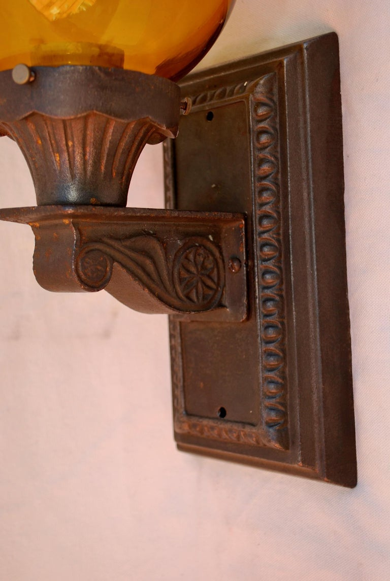 American Elegant Pair of 1920s Cast Iron Outdoor Sconces For Sale