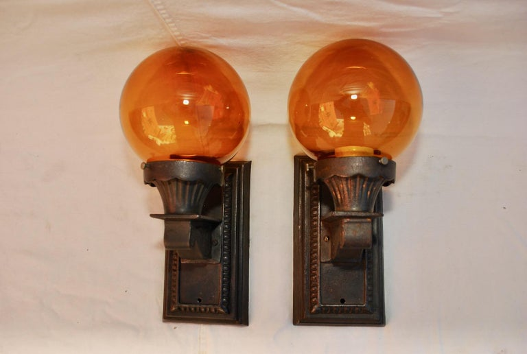 Elegant Pair of 1920s Cast Iron Outdoor Sconces In Good Condition For Sale In Los Angeles, CA