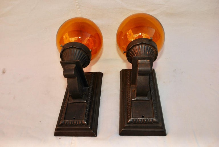 Early 20th Century Elegant Pair of 1920s Cast Iron Outdoor Sconces For Sale