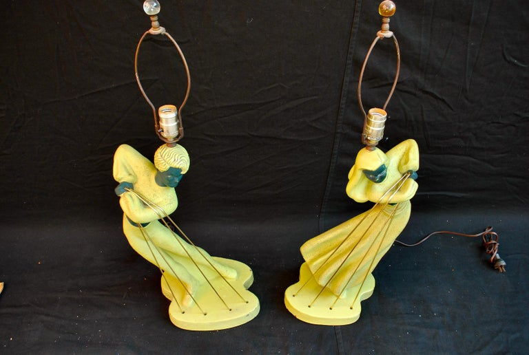 A beautiful pair of 1940's table lamps, the gold cords have been replace.