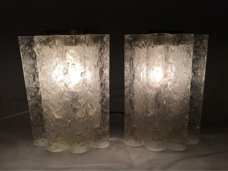 Elegant pair of ice glass tubes and brass sconces by Doria of Germany. 1960s Germany, rewired to meet US standards. Each fixture requires on European E14 candelabra style bulb up to 40 watts max. Will be shipped directly from Germany.