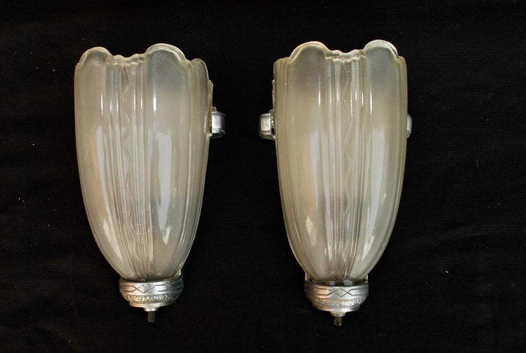 A sexy pair of 1920s Art Deco sconces, the glass is a little whiter and nicer in person, you can see in one picture, I think it is the flash of the camera that change the color of the glass.