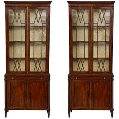 Pair of English Mahogany Book Cases with glass doors and leather writing surface