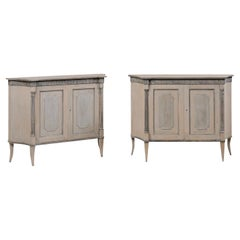 Elegant Pair of French Inspired Two-Door Cabinets Raised on Sabre Legs