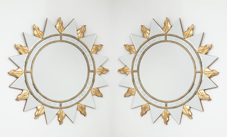 Sun themed mirrors are encircled by floral design etching, giltwood