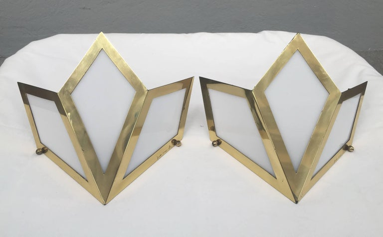 Brass and white Lucite sconces by Gabriella Crespi. Signed.