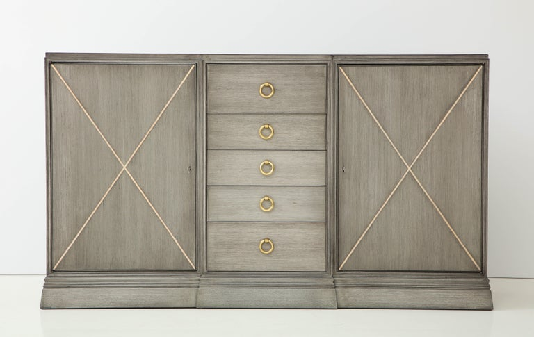 Stunning newly refinished Parzinger for Charak cabinet. The cabinet has been beautifully refinished in a soft gray tone with polished brass pulls. The interior sides of the cabinet have a satin black finish.