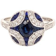 Elegant Platinum and 0.93 Carat Center Round Sapphire Diamond Ring