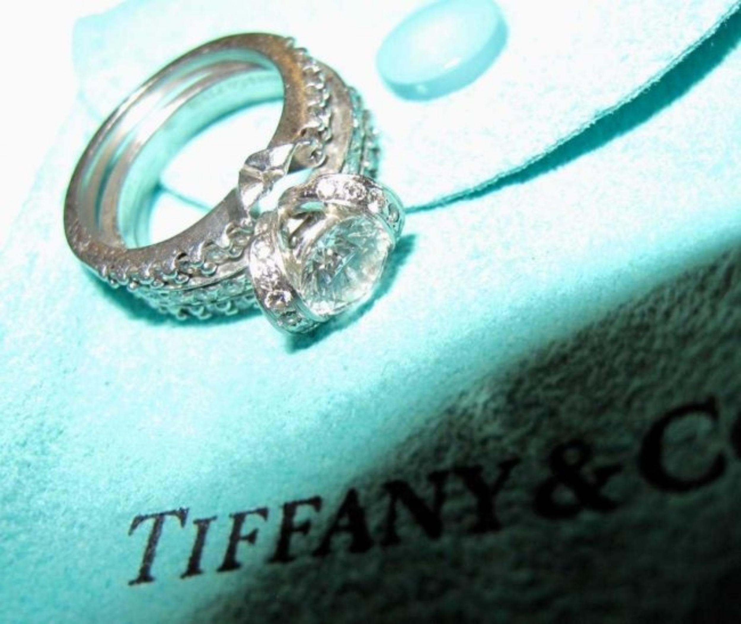 b6897acb17f38 Elegant Platinum and Diamond Bow Ribbon Ring by Tiffany & Co