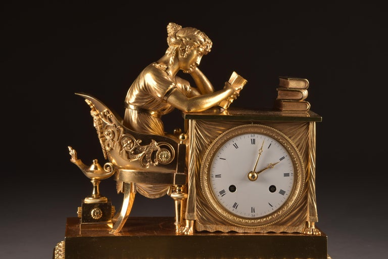 Beautiful French Empire library mantel clock, gilded bronze, early 19th century France, circa 1810 Power reserve: 8 day movement Striking: Half hour, one bell  This clock has recently been serviced and works well, it comes with a pendulum and