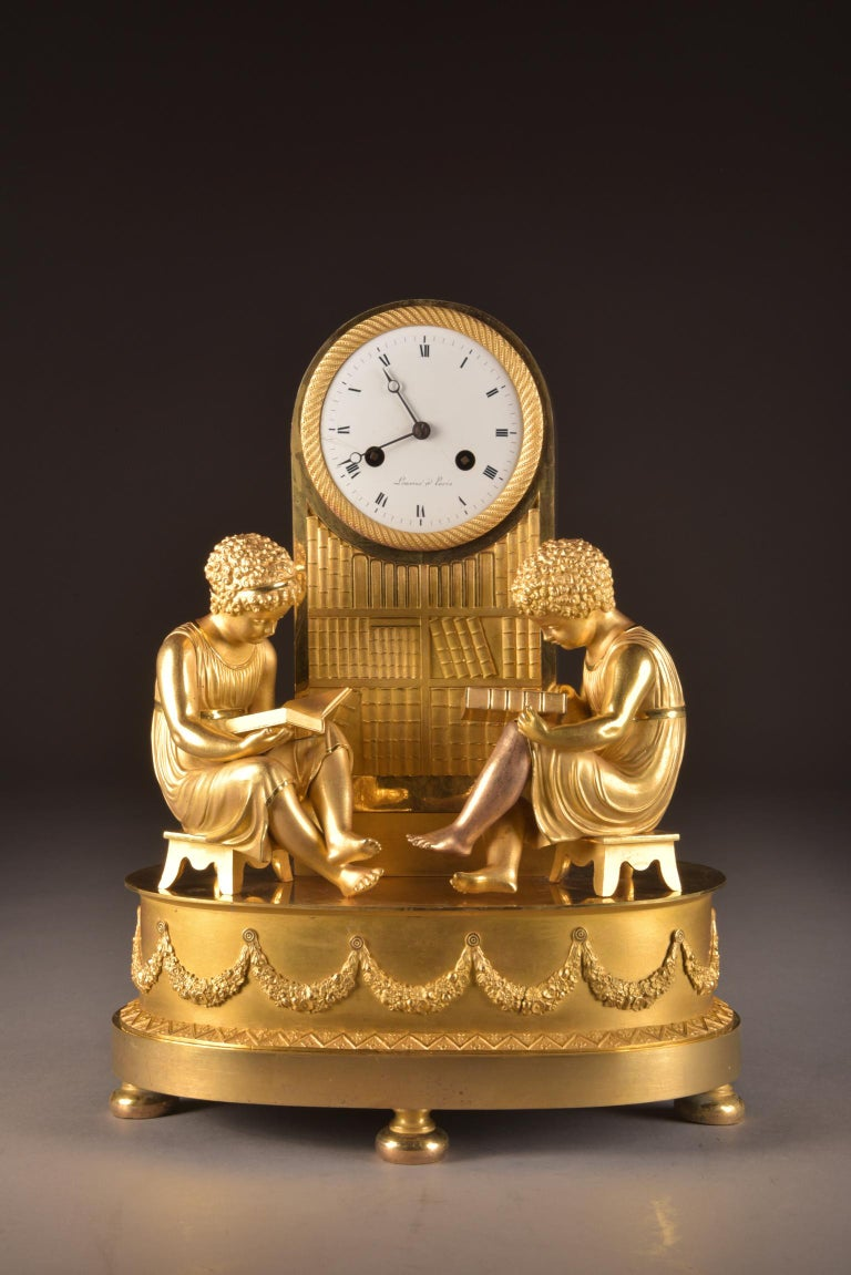 Beautiful fire-gilt library pendulum. France, circa 1810, signed: JEAN-CLAUDE LEMOINE Power reserve: 8 day movement Striking: Half hour, one bell  This clock has recently been serviced and works well, it comes with a pendulum and key.