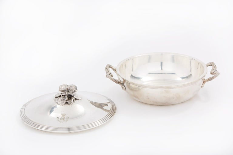 Elegant and refined French silver plated tableware covered dish / serving piece with side handles and exterior design details. The dish is in great condition. Minor wear consistent with age / use. Numbered & mark undersigned. The tureen stands about