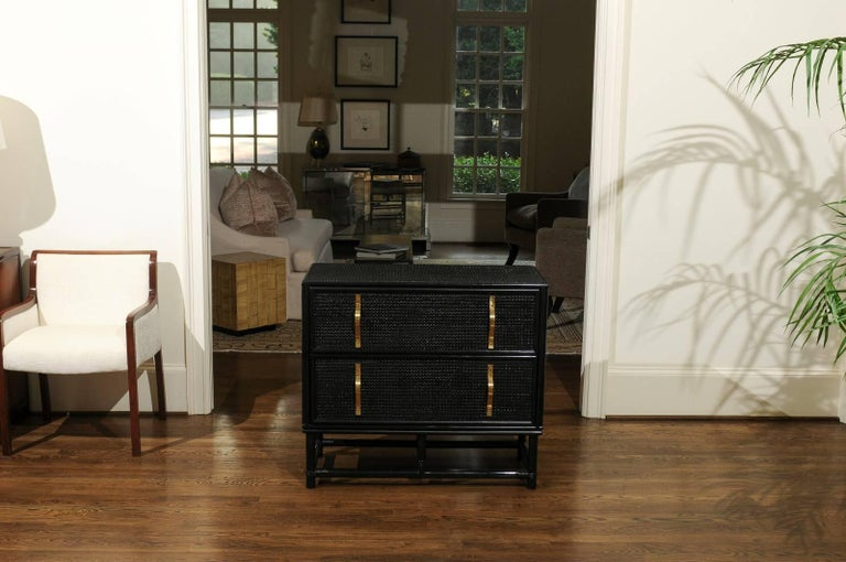American Elegant Black Lacquer Cane and Brass Commode by Tommi Parzinger - Pair Available For Sale
