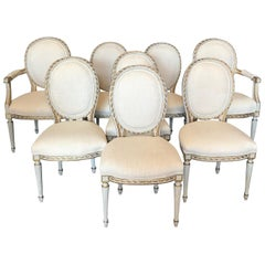 Elegant Set of 8 French Painted and Gilded Dining Chairs with New Upholstery