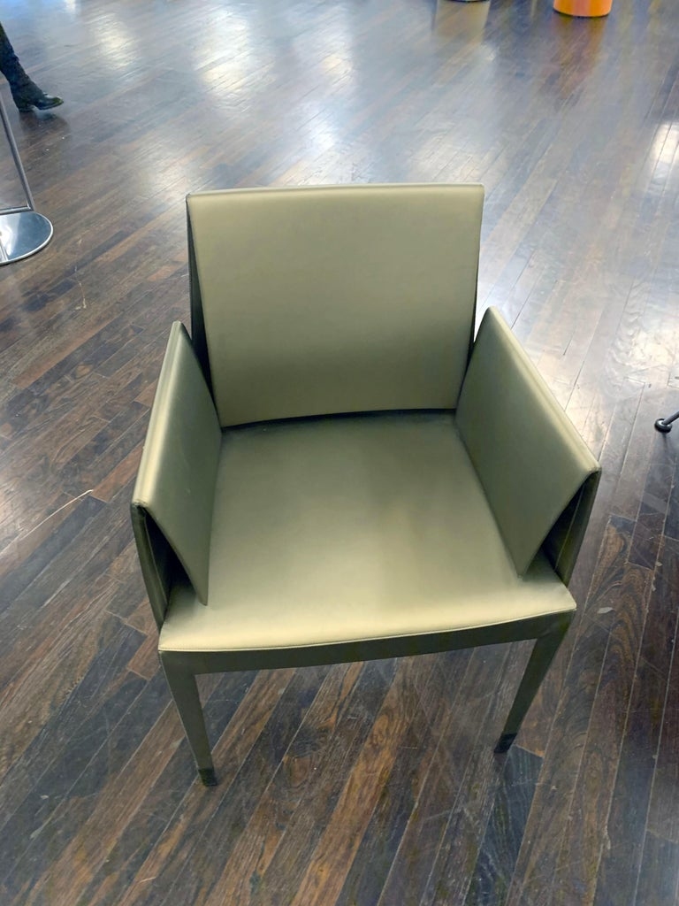 """Cerruti Baleri, Mari chairs (2) Side (2) Arm Chair: 45 x 52, h 81 Armchair: 56 x 53, H 81 This """"supersleek"""" creation seemingly made out of air and a clever idea is surprisingly comfortable."""