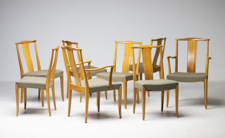 Elegant set of Nordiska Kompaniet dining chairs, consisting of 6 side chairs and 2 armchairs. Beautifully carved mahogany, a paragon of Scandinavian craftsmanship. Later upholstery in very good condition, re-upholstery available upon request. The