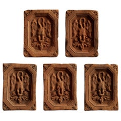 Elegant Set of Tiles with Mysterious Winged Creature Relief