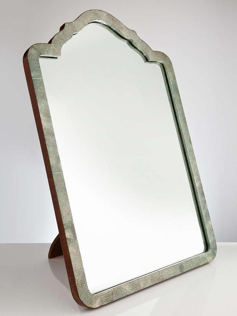 An elegant pale green shagreen French Art Deco table mirror circa 1930 with a wonderful arch-top form.  On reverse it has an easel leg or if needed could be hung.  We are always adding to our 1stdibs catalogue so be sure to add us to your