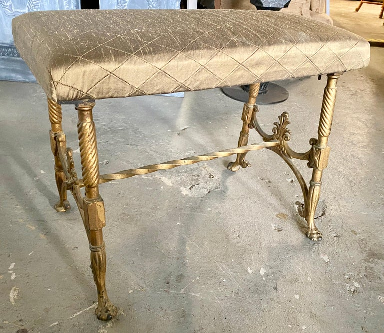 Antique Victorian period gold gilt cast iron metal bench. Seat is newly recovered in diamond pattern upholstery. Will make a wonderful extra seat in the boudoir or dressing room.  Footstools Ottomans and poufs Stools Hollywood Regency.