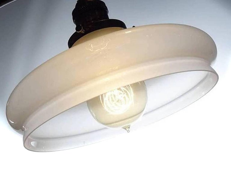 These thin and delicate shades have glass that sweeps from translucent to almost clear. Vaseline glass cast a very rich warm and pleasing light. We like the look ourselves and have a Vaseline fixture over our own dining room table. This sconce has