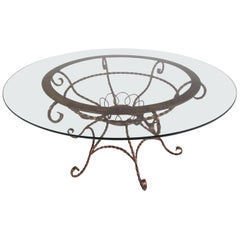Elegant Vintage Wrought Iron Coffee Table with a Glass Top