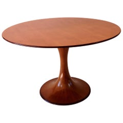 "Elegant Walnut Round Center Dining Table ""Clessidra"" by Luigi Massoni, 1959"
