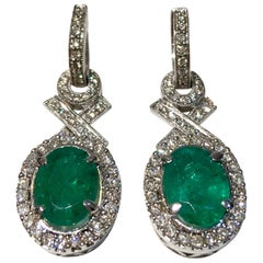 "Elegant ""XO"" Oval Emerald and Diamond Halo 18 Karat White Gold Drop Earrings"