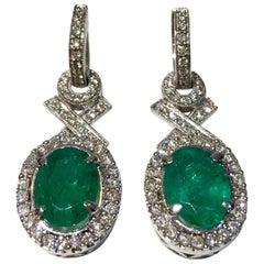"Elegant ""XO"" Oval Emerald and Diamond Halo 18 Karat White Gold Drop Earrings"