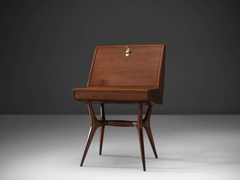Writing table, wood, Italy, 1950s  Beautifully and elegantly shaped Italian secretary in wood. The legs are unmistakably Italian and are angled outwards which give this piece a firm appearance. The proportions of this small secretary are very well