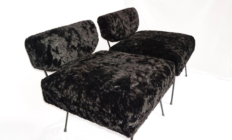 Elettra chair, midcentury matching twin black plush faux fur armchairs with painted tubular metal frames, designed by Studio BBPR in Italy, 1954 for Arflex. These chairs are one of the most iconic pieces of furniture designed by Studio BBPR, a
