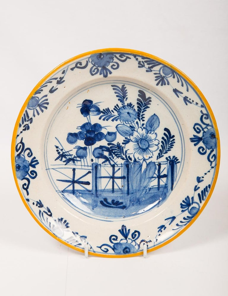 Eleven blue and white Dutch Delft dishes hand painted in the 18th century showing a variety of traditional scenes including a deer in the forest, floral bouquets, and gardens overflowing with peonies (see images). The decoration on each dish in the
