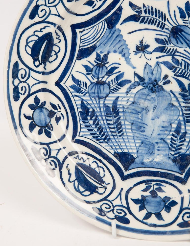 Eleven blue and white Delft chargers dating from the mid-18th century to circa 1800.