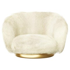 ELF Swivel Lounge Chair in Angora Goat or Islandic Sheepskin, liquid bronze base