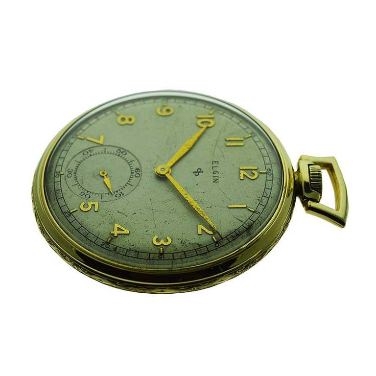 FACTORY / HOUSE: Elgin Watch Company STYLE / REFERENCE: Open Faced Pocket Watch METAL / MATERIAL: Yellow Gold Filled CIRCA / YEAR: 1940's DIMENSIONS / SIZE: 45 mm MOVEMENT / CALIBER: Manual Winding / 15 Jewels  DIAL / HANDS: Original Silvered with