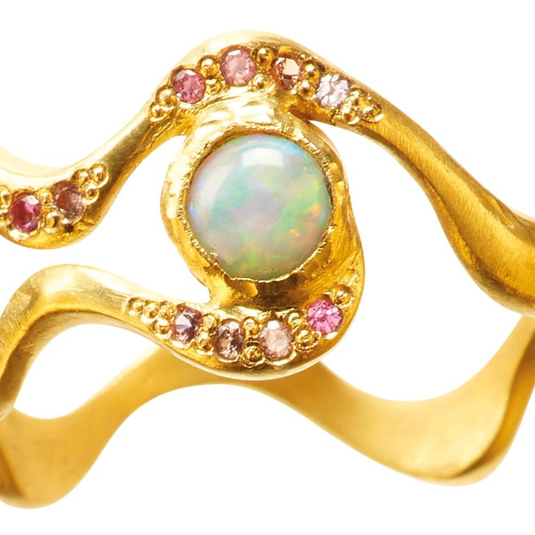 The Opal Eye ring is handcrafted in 18k gold, studded with 10 x spinels & 1 white water opal. It is beautiful on its own or combined with other ELHANATI rings.  The ring is from Mark Me Pink, the second edition of Mark Me Sky, inspired by the latest