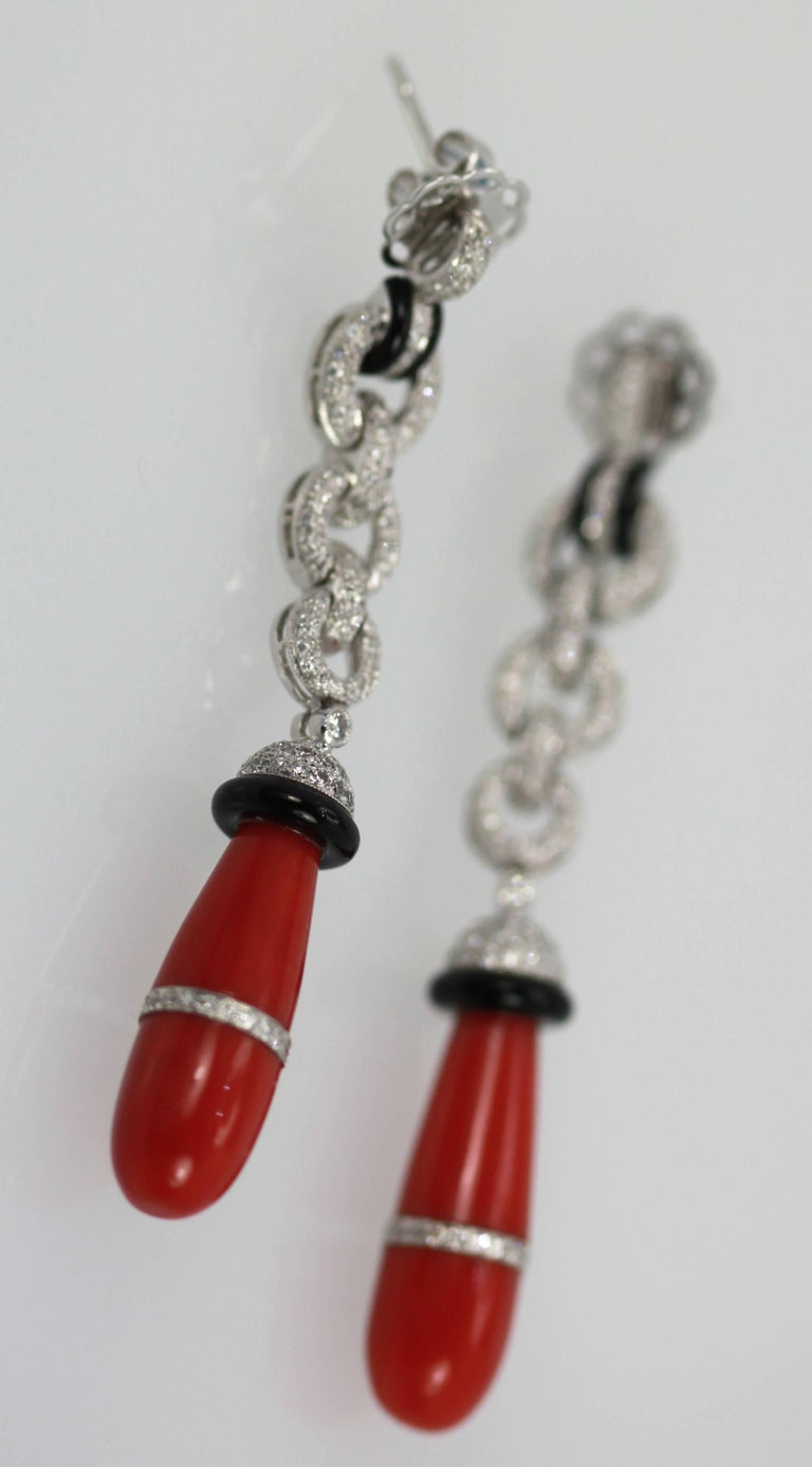 Drop Dead gorgeous Eli Frei Coral Earrings are amazing.  Each Earring features a butterfly post with Pave Diamonds thoughout, gorgeous natural Coral teardrops with a band of Diamonds aroud each Coral stone.  Onyx circle on top of Coral and at top of