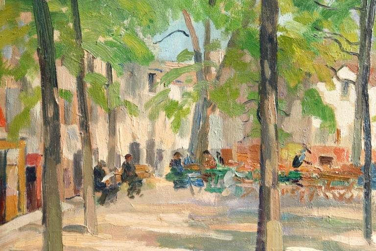 A beautiful oil on canvas circa 1910 by Russian painter Elie Anatole Pavil depicting a view of Place du Tertre in Montmartre, France. The sun shines through the green trees and people enjoy breakfast al fresco in the warm