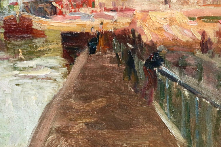 A beautifully coloured oil on canvas by Elie Anatole Pavil depicting boats on the canal at Quai de la Gironde -  a quay located along the Canal Saint-Denis, in Paris, in the 19 arrondissement. Signed lower right and titled with original exhibition