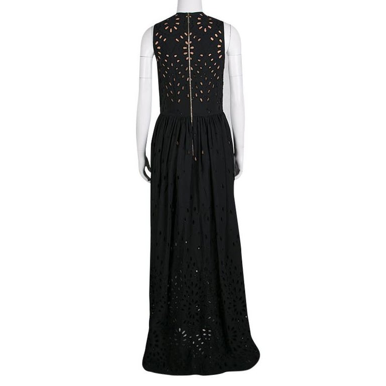 Long dramatic gowns with laser-cut to floral effect were the highlight of Elie Saab's Spring-Summer 2016 Ready to wear collection. This maxi dress is gloriously crafted with a cotton blend in black color featuring eyelet embroidery all over. It has