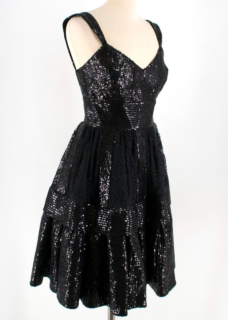 Ellie Saab Black Sequin & Lace Dress   - black sequin dress - lace embellishment to the skirt - sleeveless - v neckline  - lined - double zip fastening to the back   This seller usually wear size XS.   Please note, these items are pre-owned and may