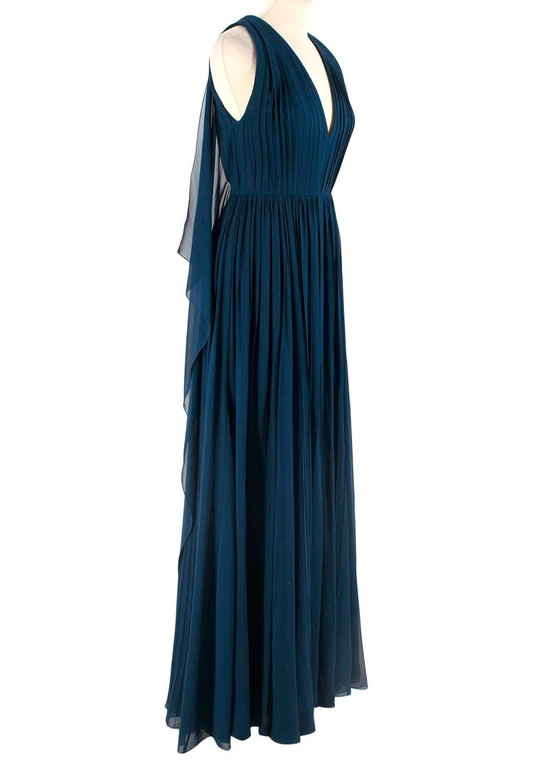 Elie Saab Blue Pleated silk-chiffon gown  - Flowy panels on back - Zipper and hook in good condition - Thin belt at waist - Sewn line detail - Sleeveless; v-neck  Please note, these items are pre-owned and may show signs of being stored even when