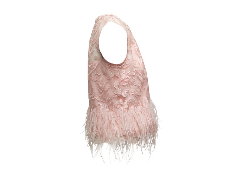 Product details: Light pink sleeveless top by Elie Tahari. Lace trim at crew neck. Applique embroidered detailing throughout. Ostrich feather trim at hem. 37