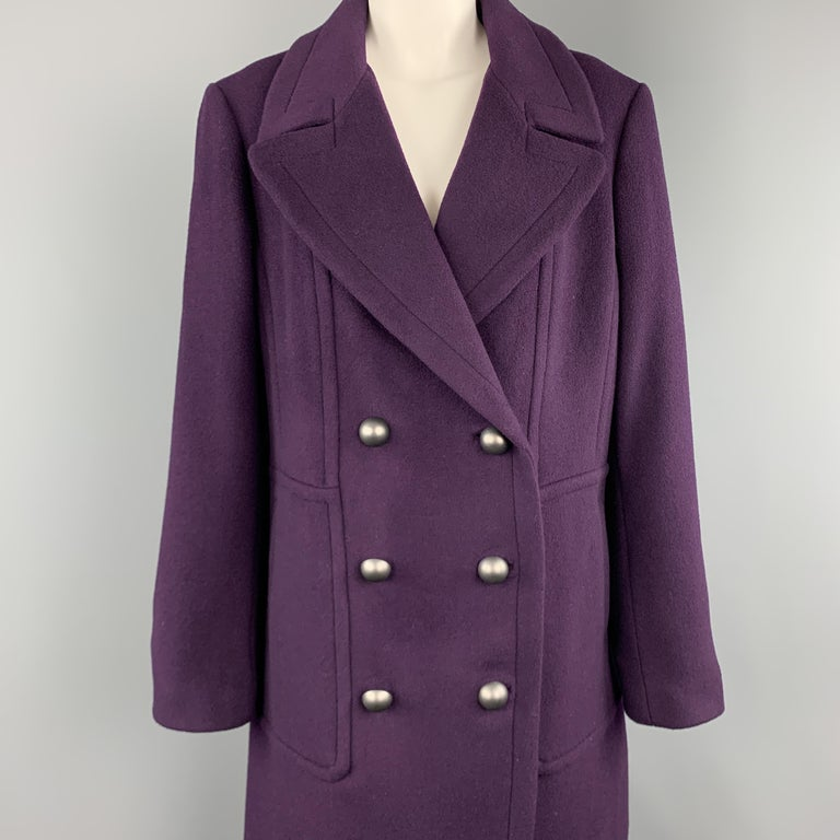 ELIE TAHARI coat comes in plum purple wool blend flannel with a pointed lapel, double breasted metal button front, and slit pockets.   New with Tags. Marked: L  Measurements:  Shoulder: 18 in. Bust: 44 in. Sleeve: 26 in. Length: 41 in.